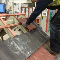 Apprentice Harry working on roof tiling at college