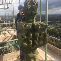 Site foreman assesing the damage to the stonework on the pinnacle