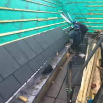 Image showing new slates being laid to the roof of the chapel