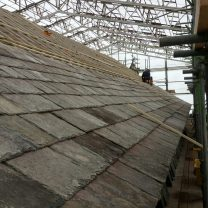 Image showing initial slates being laid on the roof of the church