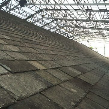 Image showing roof slates below scaffold covering