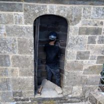 Image showing the new stonework being installed on the spiral staircase leading up to the Nave Roo