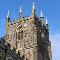 Image showing the new Pinnacles standing tall, along with new masonry to the Belfry Windows on the Tower