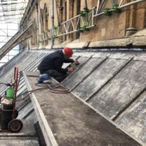 Image showing one of our Lead workers welding the new vents into position