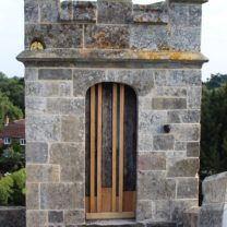 Image of the restored Turret door and surrounding masonry and repointing
