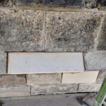 Image showing a new piece of stone to fit into the existing stringcourse to help prevent any rainwater damage to the stonework below