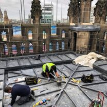 Image showing the final touches to the new Lead roof of the Tower prior to the Composite decking being laid