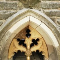 Image of the newly carved and installed Tracery window along with new voissours fitted into place