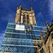 Image of the clock being lifted up the Tower Manchester Cathedral