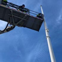 Image showing a Cherry Picker being used to carry out the installation of the new flag pole at the top of the Tower