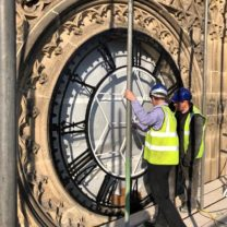 Image showing Architect Mark Pearce inspecting the new Clock Faces