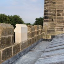 Image showing one new Battlement stone in a row of existing ones