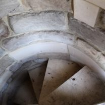 Image showing the new stonework installed to the walls and steps of the spiral staircase leading up to the Nave Roof