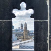 Image showing a View of the Town Hall through one of the Parapet openings on the Tower roof