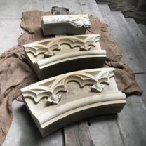 Image showing Newly carved sections of the clock surround ready to go to site