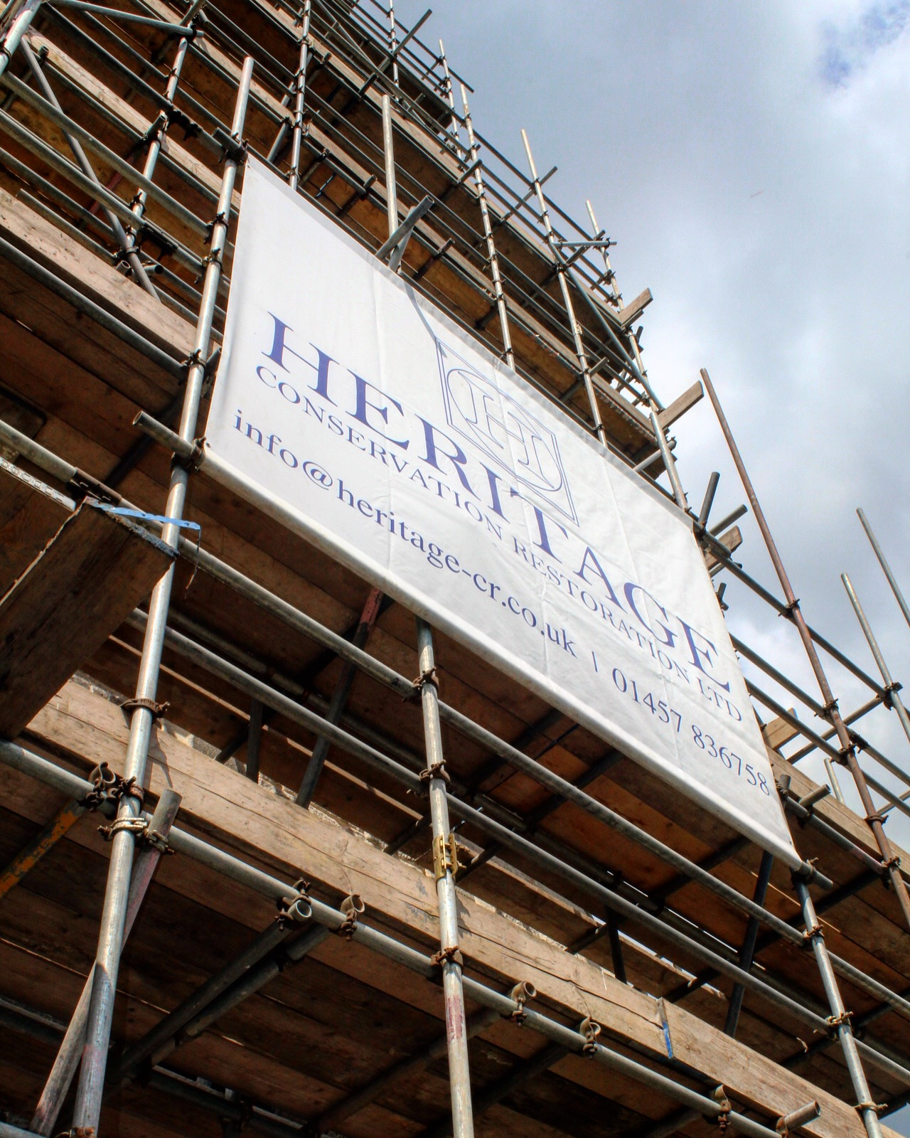 Heritage signage on the scaffold up the Spire at Christ Church