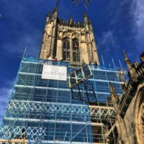 Image showing Clock Face being hoisted up the scaffold ready for installation