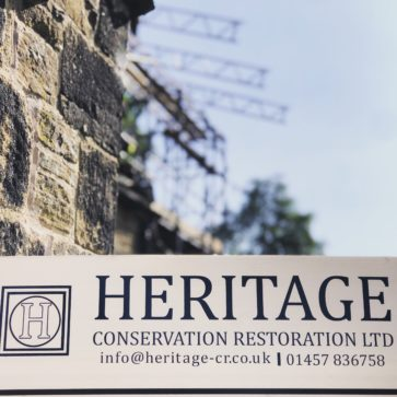 Heritage sign in the foreground, with temporary roof scaffold beiing installed in the background